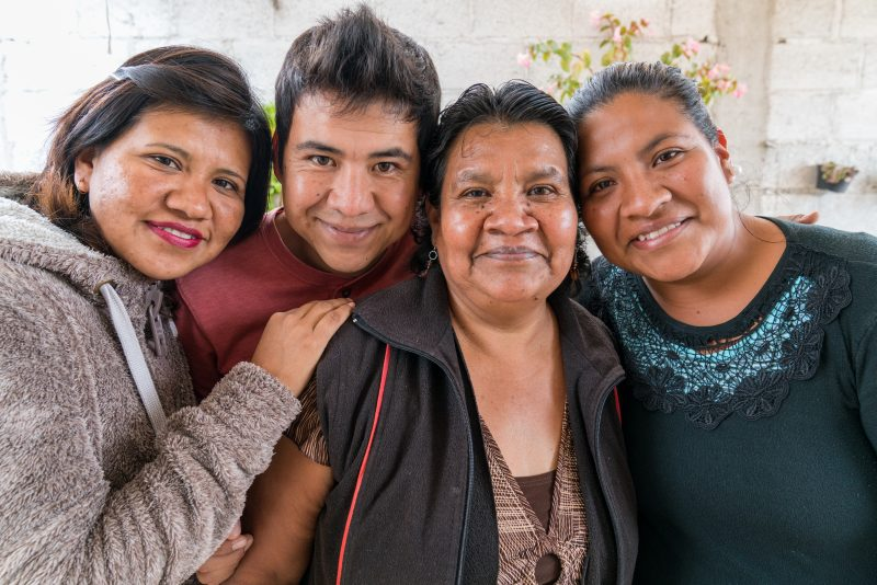 IXMIQUILPAN, HIDALGO, MEXICO (11/03/16)- The Gutiérrrez Family stand in front of the home they helped build with Habitat for Humanity in Hidalgo, Mexico. Valentina Ángeles, Lorena Ángeles (32), Ana Laura Vargas Ángles (28, black sweater), and Armando Vargas Ángles (25). ©Habitat for Humanity International/Jason Asteros