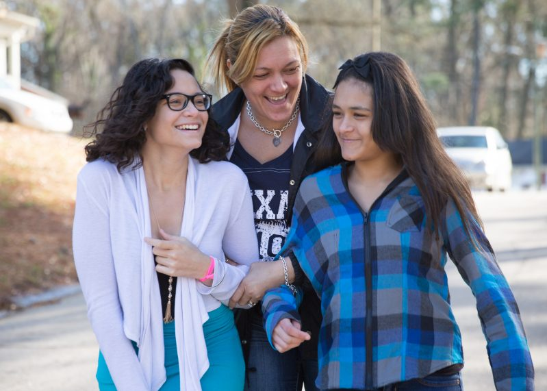 RALEIGH, NORTH CAROLINA, USA (1/19/15)-Barbara Gotay (center) partnered with Habitat for Humanity of Wake County to buy her home in Raleigh, North Carolina. Gotay and her daughters, Crystal Gotay (left, 17, and Amaryllis Carrillo (right, 11), are active in a coalition of residents and community partners working to revitalize the Long Acres neighborhood. Habitat of Wake County is one of Habitat's first Neighborhood Revitalization affiliates.     © Habitat for Humanity International/Ezra Millstein